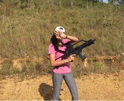 One of the images which surfaced online yesterday, allegedly showing a cabinet minister's relative undergoing training with a high-tech weapon.