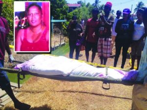 The bod of Bhumattie Delall being removed from her home on Wednesday