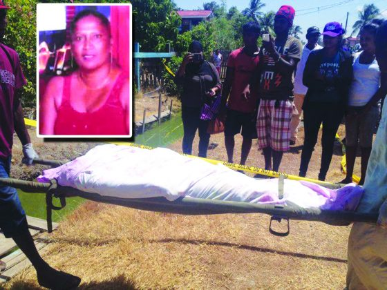 The body of Bhumattie Delall being removed from her home on Wednesday last