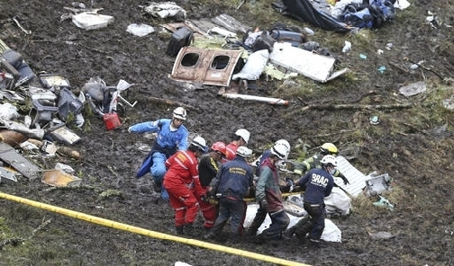 Rescue workers recover a body from the wreckage site of an airplane crash, in La Union, a mountainous area near Medellin, Colombia, Tuesday November. 29, 2016. The chartered plane was carrying a Brazilian soccer team to the biggest match of its history when it crashed into a Colombian hillside and broke into pieces, Colombian officials said Tuesday. (Photo: AP)