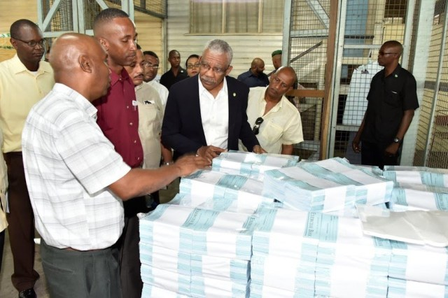 President David Granger inquiring about the printing process of exercise books