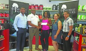Clive Pellew (second left) of Banks DIH presents his company's sponsorship package to Noshavyah King in the presence of (from left) Errol Nelson, Jordana Ramsay-Gonsalves and Jamie McDonald