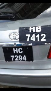 The car held a misleading licence number HB7412 stuck over the original licence number, HB7294. ( Timothy Bhagwandin photo)