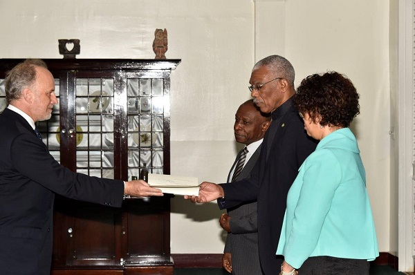 Ambassador Roland de Rosière presenting his Letters of Credence to President David Granger at State House