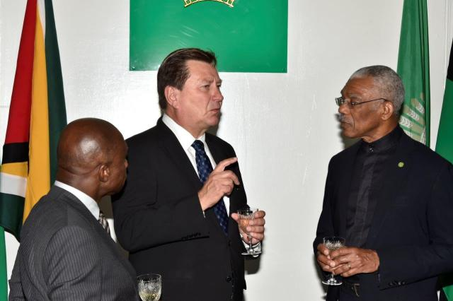 Foreign Affairs Minister, Mr. Carl Greenidge, Ambassador Jukka Pietikäinen and President David Granger conversing after the accreditation ceremony at State House