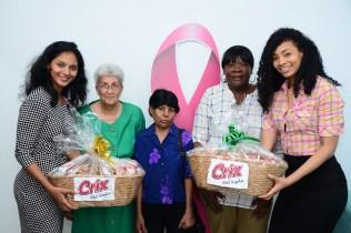 Pinktober Ambassador Ambika Ramraj (l) and GTT Ambassador Timeka Marshall (r) with recipients of the Care Packages