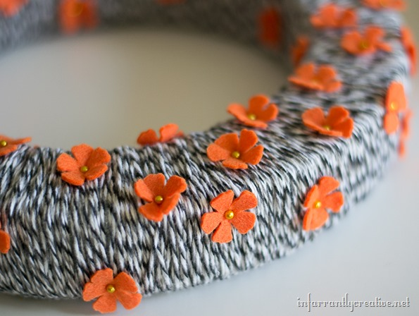 orange and black flower wreath