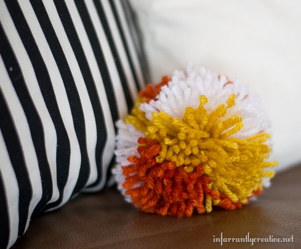 pom poms on a pillow