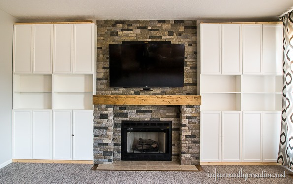 stone fireplace with built in cabinets