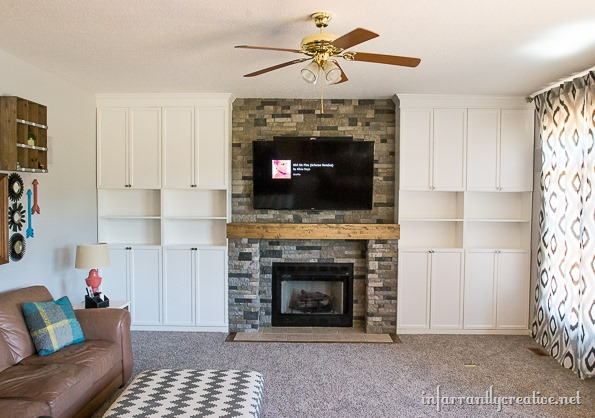 stone fireplace with built-ins