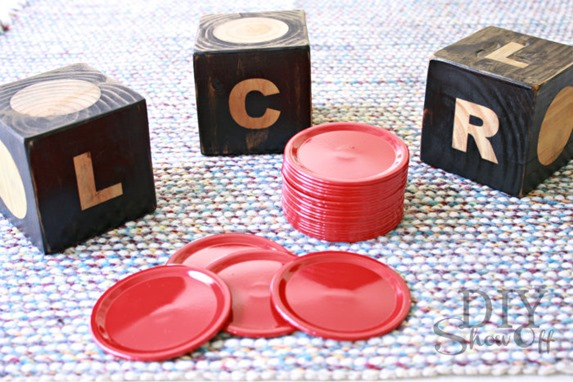 Make your own outdoor LCR game from a 4x4 and canning lids!