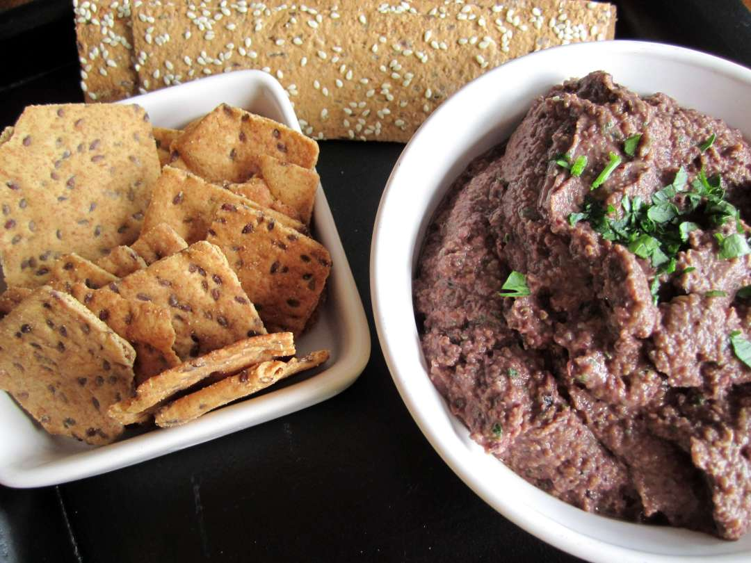 olive and lentil tapenda with crackers for dipping