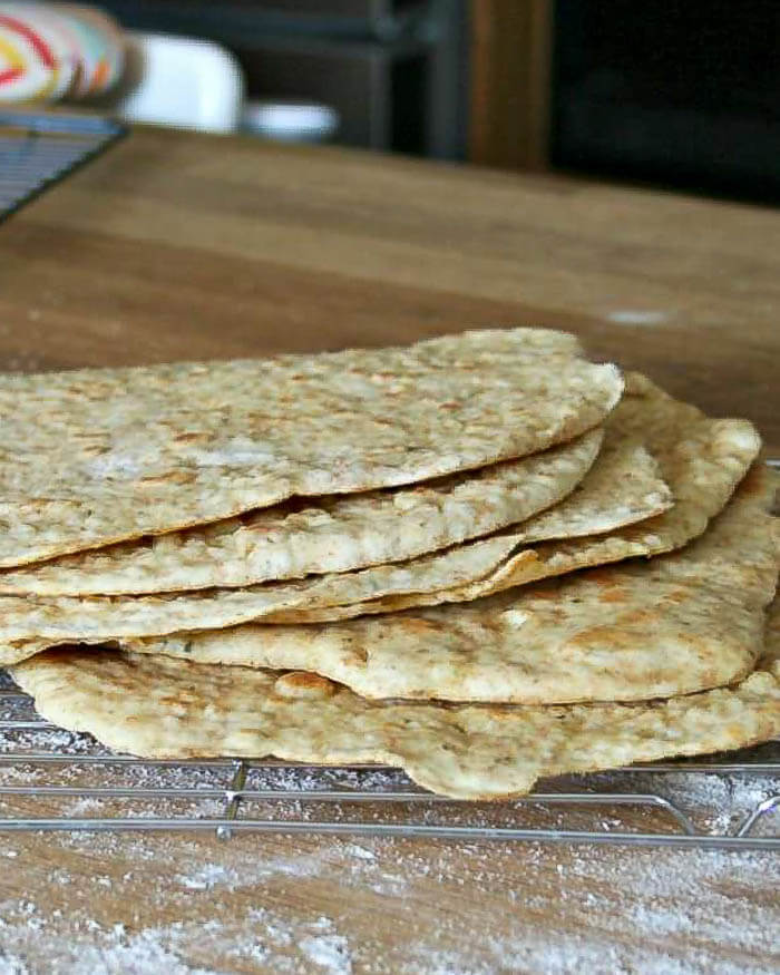 a stack of homemade flatbreads on a cooling rack