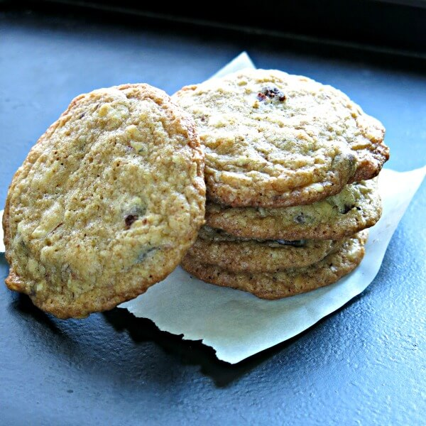 Chocolate Chip Hazelnut Cookies stacked on a piece of parchment paper