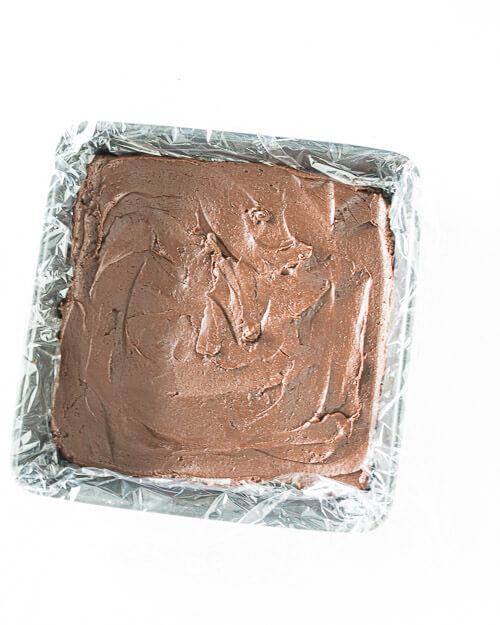 fresh fudge poured into prepared baking tin and raedy to be chilled