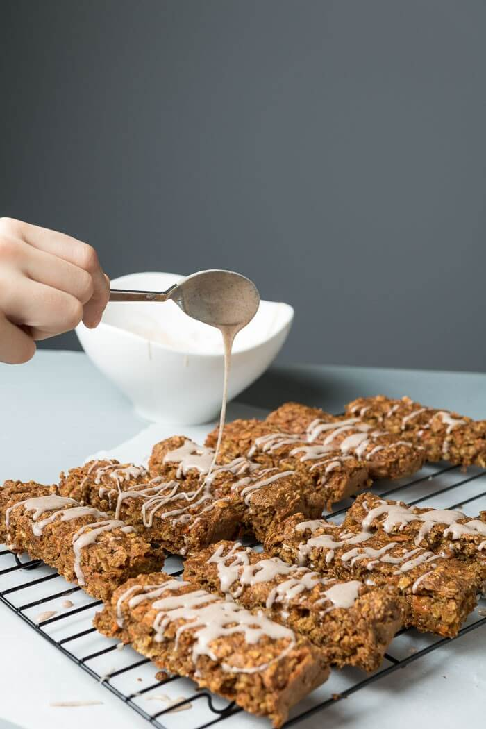 Carrot Cake Breakfast Bars with cinnamon frosting drizzled on
