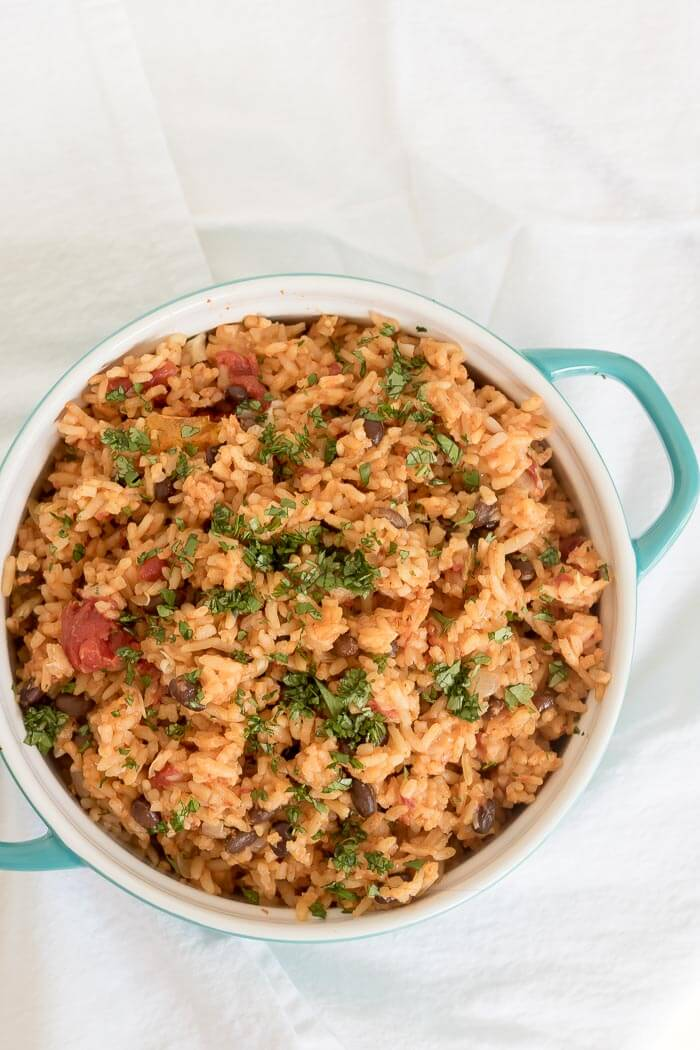 vegetarian spicy mexican rice casserole with black beans and cilantro on top
