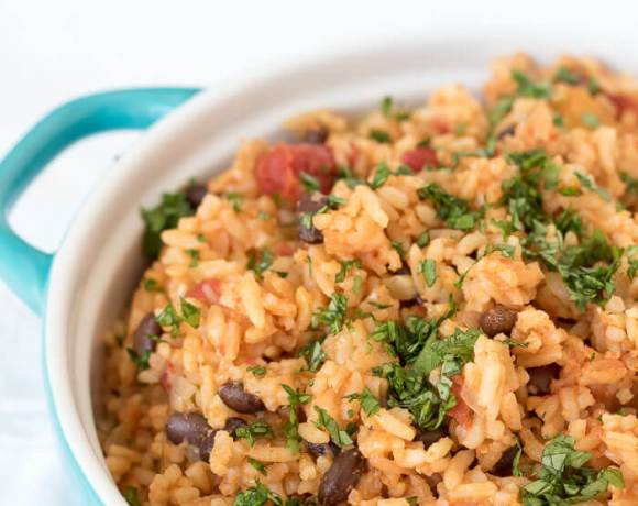 chipotle rice casserole with black beans and cilantro on top