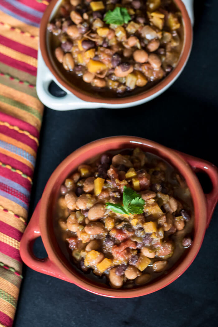 Vegan Butternut Chili in two bowls with colourful napkin