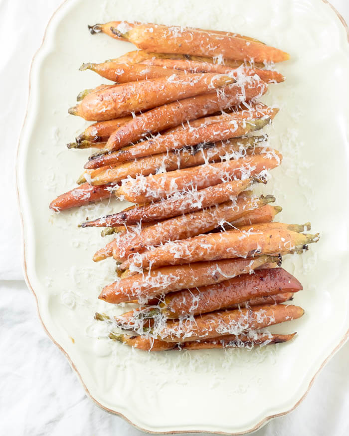 Balsamic Roasted Carrots sprinkled with parmesan on a platter