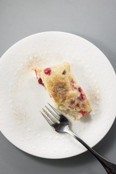 slice of cranberry cake on white plate