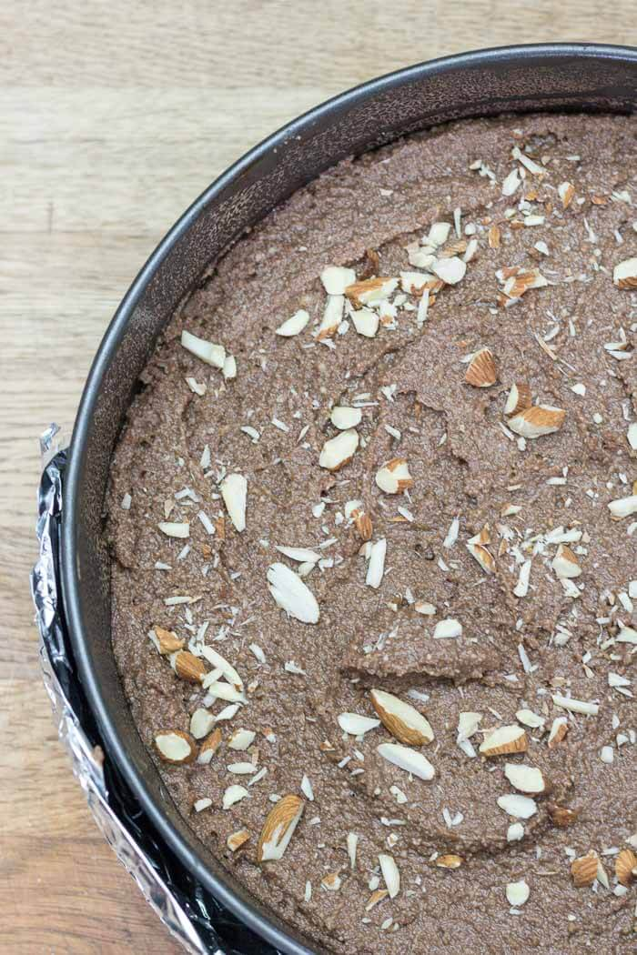 Dark Chocolate Ricotta Cake with Almonds - ricotta makes for a light yet rich cake. Not too sweet or heavy. This cake is flourless making it prefectly gluten-free!