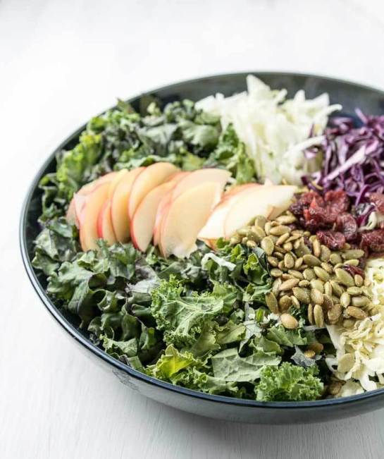 kale, apple and cabbage salad with pumpkin seeds, fennel and cranberries