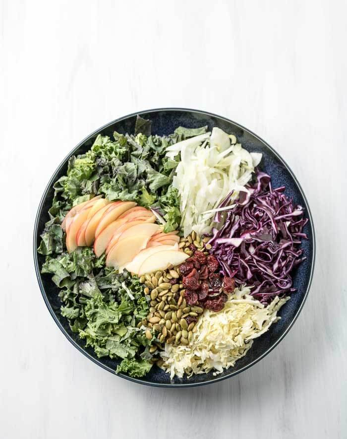 kale, apple, cabbage salad with fennel and pumpkin seeds and cranberries