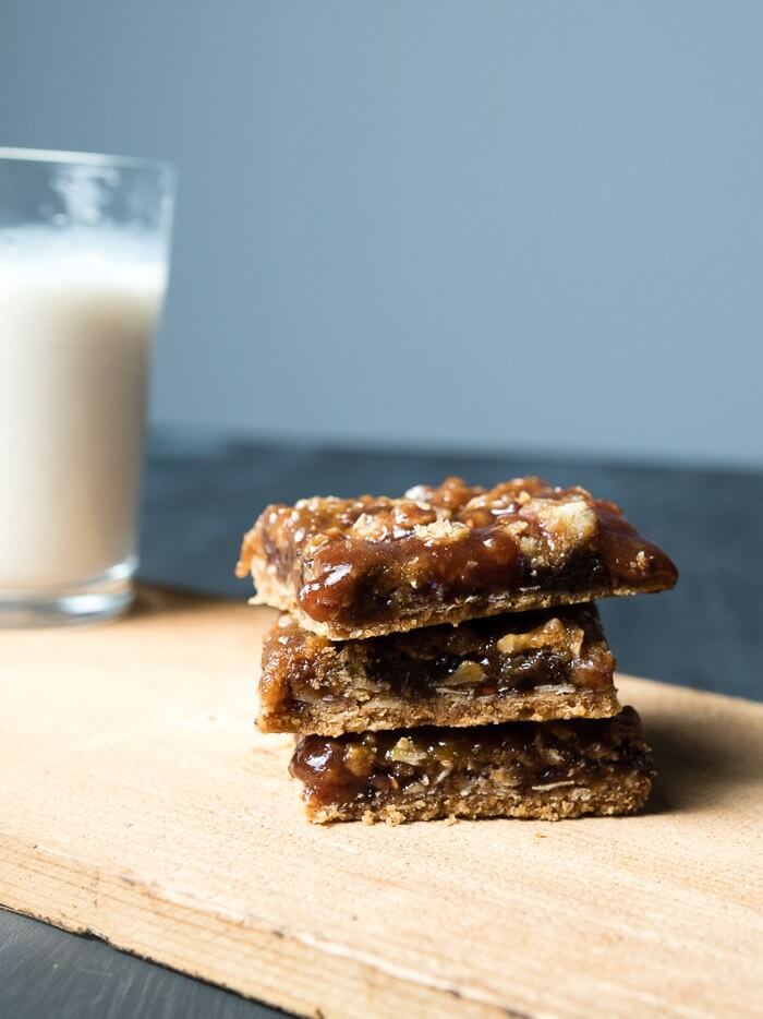 chocolate raspberry bars with a glass of milk