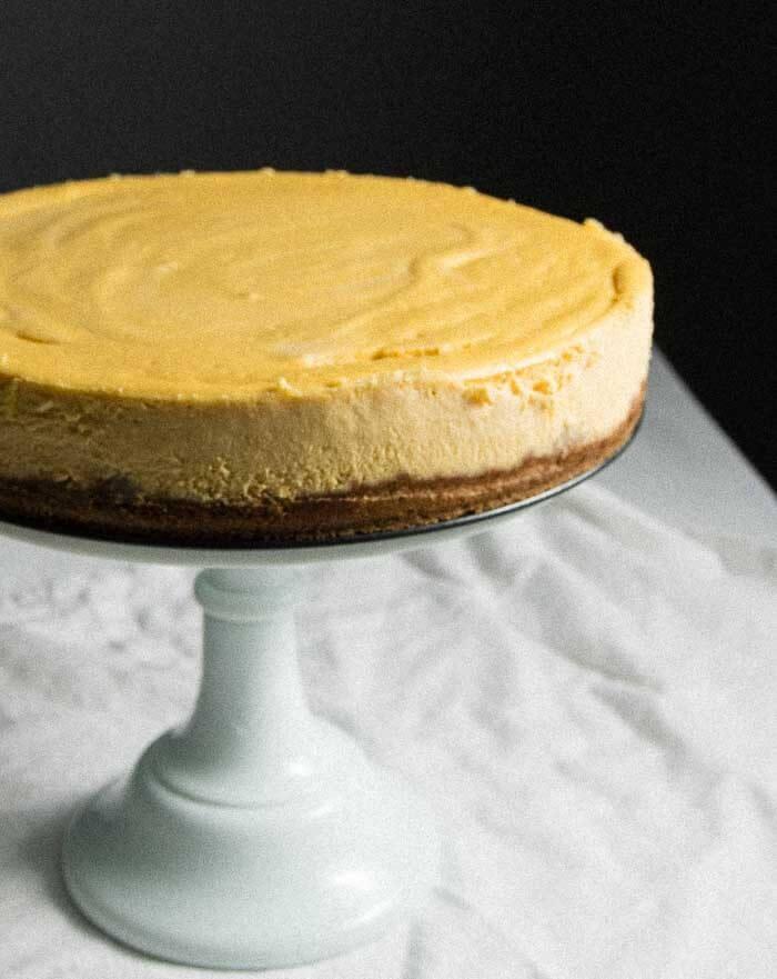 Banana cheesecake on a cake stand. Oatmeal cookie crust.