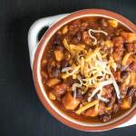 Sweet Potato and Black Bean Chili with Cheese on top