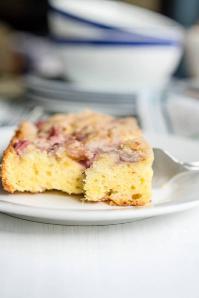 A slice of strawberry rhubarb coffee cake on a plate
