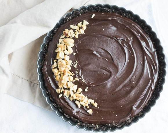 chocolate peanut butter tart with peanuts