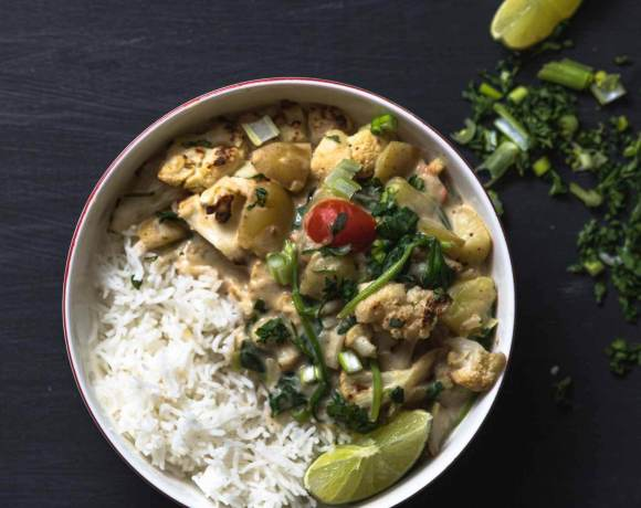 cauliflower coconut curry served with lime and cilantro