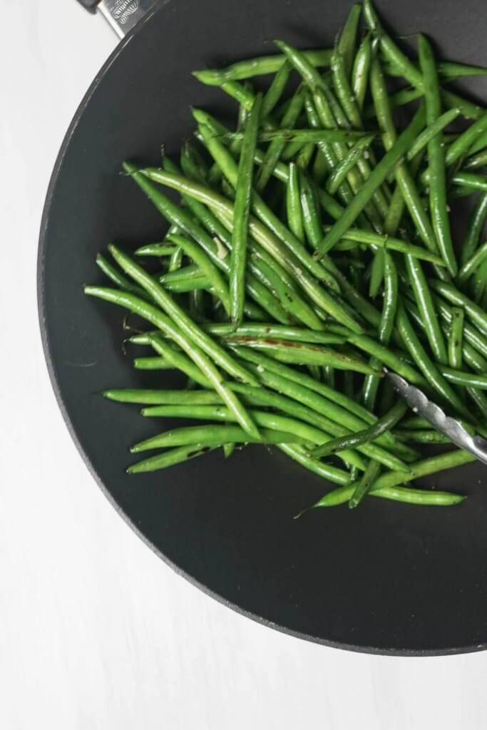 prefectly stir-fried green beans are tender crisp and slightly charred