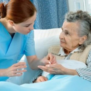 Nurse cares for a elderly woman lying in bed; Shutterstock ID 75178384; PO: aol; Job: production; Client: drone