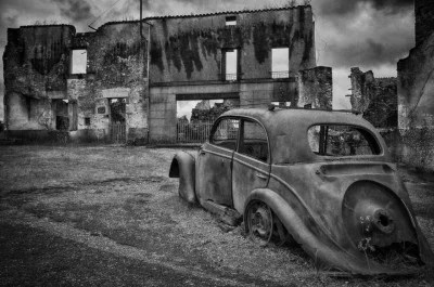 A rusting car in Oradour-sur-Glane
