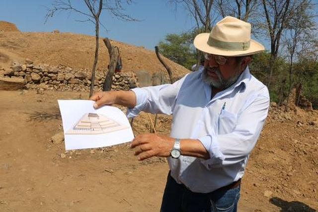 Walter Alva holding in drawing with the original appearance of the temple. Megalithic Water Temple
