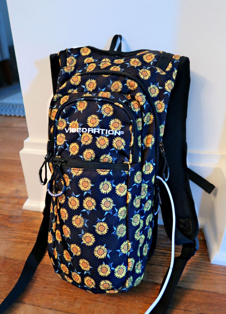 2L backpack in navy blue color with many sunflowers on it