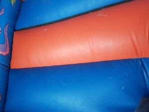 Bed seam repair on a bouncy castle