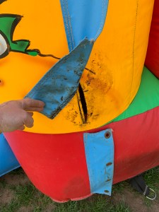 hole in the side of a bouncy castle