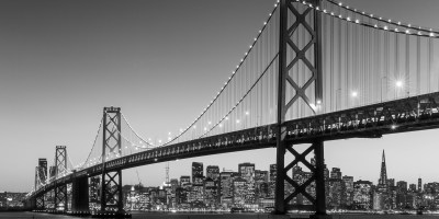 San Francisco skyline and Bay Bridge at sunset in black and white