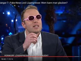 Info-DIREKT Gastautor Stefan Magnet mit rosa Brille