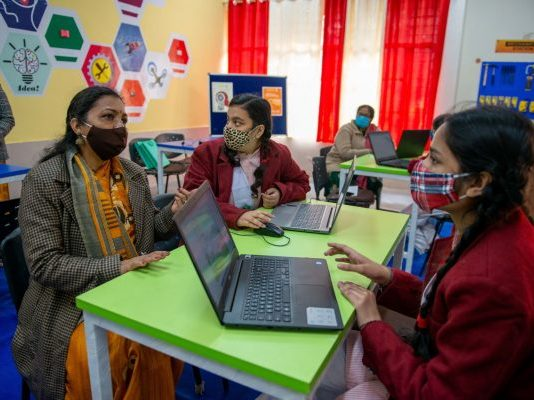 Students interacting with their teachers during the inauguration of the Atal Tinkering Lab in New Delhi, India, 17 December 2020 (Photo: Reuters/Pradeep Gaur).
