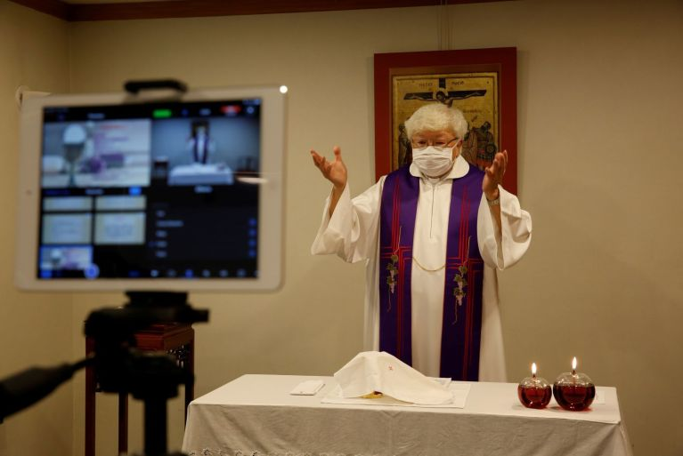 Thomas Law Kwok Fai, a priest, conducts Mass streamed online for people to mark the second Sunday of Lent, after the Roman Catholic Diocese of Hong Kong temporarily suspended public masses at churches, following the novel coronavirus disease (COVID-19) outbreak, in Hong Kong, China, 7 March 2020 (Photo: Reuters/Tyrone Siu).
