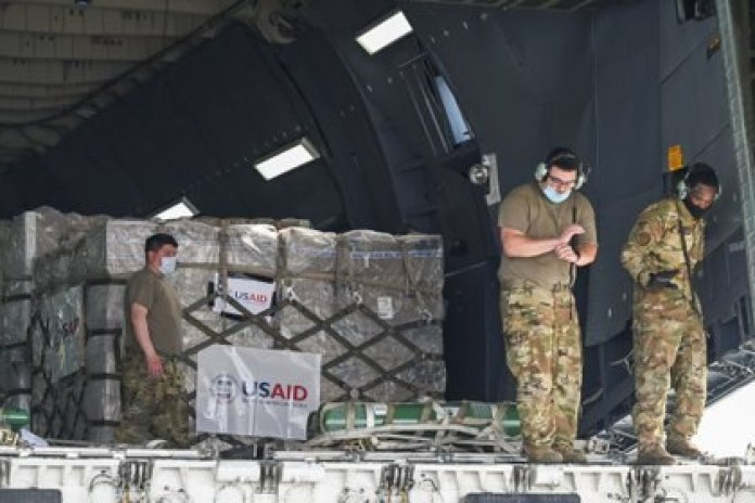 US military prepares to unload COVID-19 relief supplies at the cargo terminal at Indira Gandhi International Airport in New Delhi.  India recorded 386,000 infections in the past 24 hours (Reuters)