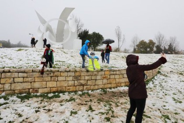 People play in the snow and take selfies on a snowy morning in Jerusalem, February 18, 2021. REUTERS / Ammar Awad