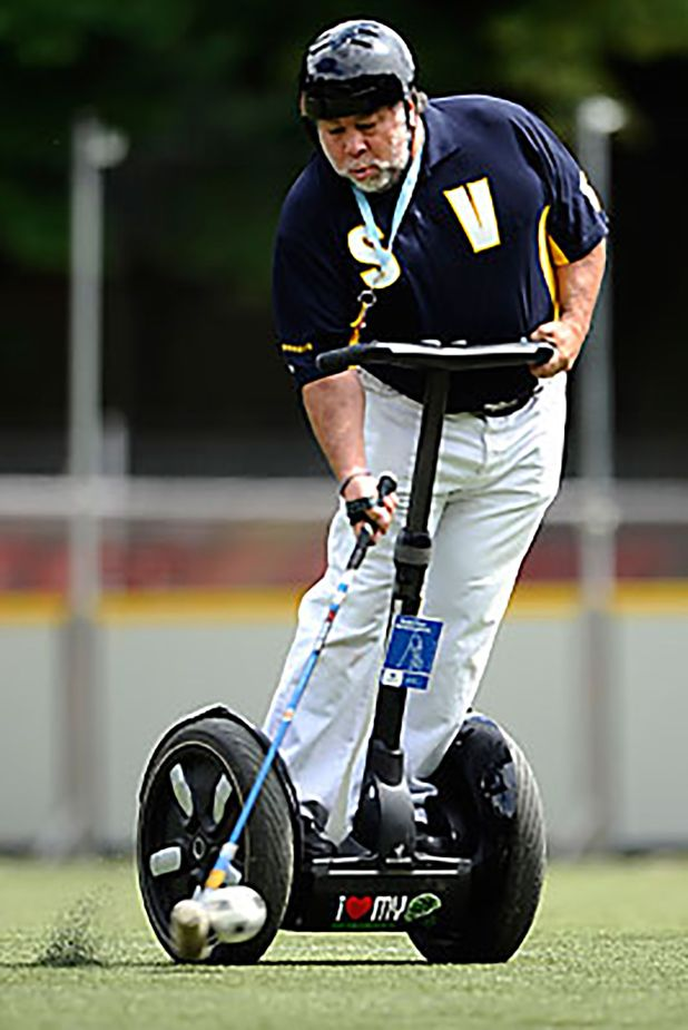 Apple co-founder Steve Wozniak of Team Silicon Valley Aftershocks shoots during their Segway-Polo World Championship match against Team Black Rose on July 17, 2009 in Cologne, where a total of seven teams compete. Segway-Polo has been invented in 2002 in the US, two teams of five players on the electric two-wheel vehicles compete on a field with two goals.  AFP PHOTO  DDP/ PHILIPP GUELLAND        GERMANY OUT (Photo credit should read PHILIPP GUELLAND/AFP/Getty Images)