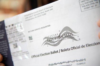 Con el resultado salido de las elecciones, Biden suma 306 delegados en el Colegio Electoral por los 232 de Trump. EFE/EPA/TRACIE VAN AUKEN/Archivo