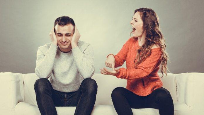 couple having argument – conflict, bad relationships. Angry fury woman screaming man closing his ears.